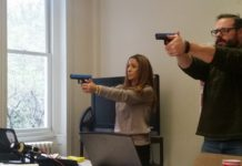 Dovrat Hadad and Richard Schmidt practice shooting in a Shot Tec firearm simulation