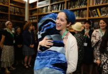Rabbanit Jenna Englender dances with the Torah