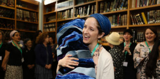 Rabbanit Jenna Englender dances with the Torah