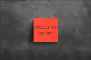 a post it note reading executive order
