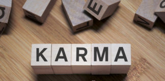 tiles spelling out karma