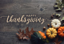 Happy Thanksgiving written next to some squashes