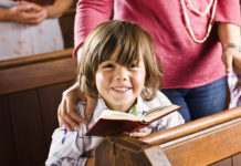 boy sitting in pew