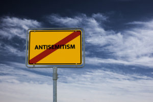 sign with the word antisemitism crossed out