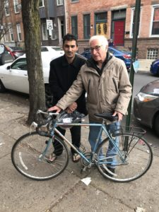 David Broida delivers a bike to Najeeb