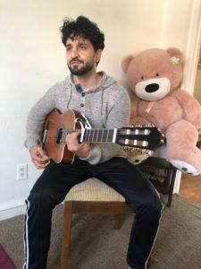 Masih Yousofi plays guitar