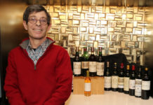 Scot Ziskind in front of bottles of wine