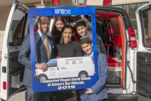 The Dombar family in front of an ambulance donated to Magen David Adom
