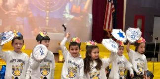 kindergartners with paper shields