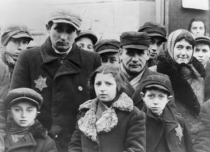 Jews wearing Star of David badges, Lodz Ghetto, Poland, 1940-1944.