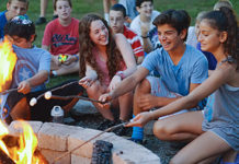 kids roast marshmallows at camp