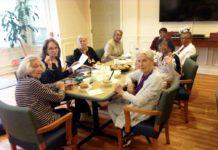 seniors sitting at a table
