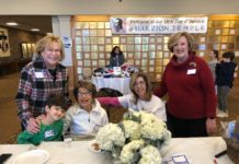 From left: Ruth Gleit, Elijah Metter, Gladys Shubin, Leta Shubin and Peggy Sterling welcome volunteers.