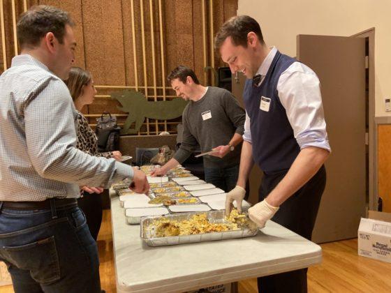 Volenteers serve food