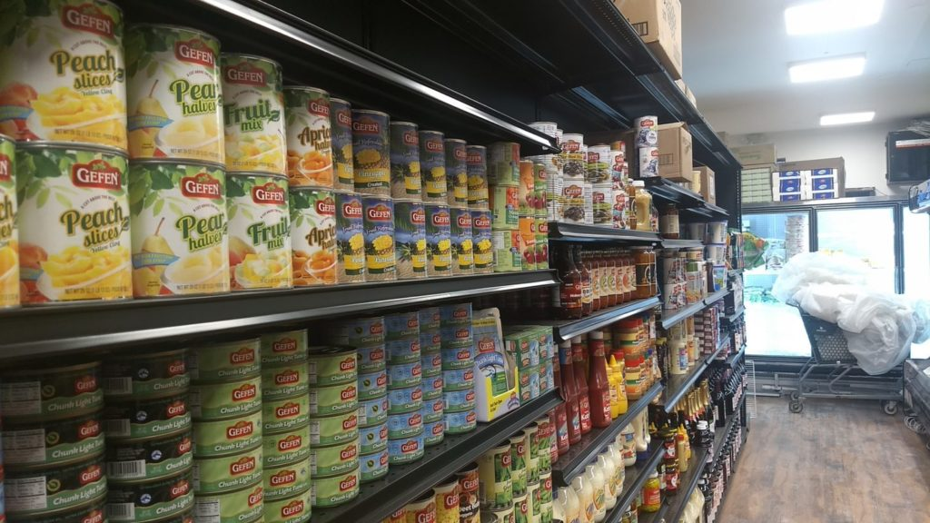 Some of JC Kosher's shelves are fully stocked with staples in its new location, two blocks away from the original store.