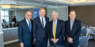 From left: Fred Strober, Ambassador Kåre R. Aas, Tom Tropp and Dean E. Grabelle.