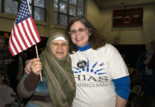 HIAS Pennsylvania Executive Director Cathryn Miller-Wilson, right, welcomes a refugee client at one of HIAS PA's 'Refugee Thanksgiving' events.