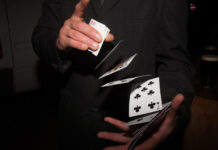 A magician shuffling a deck of playing cards