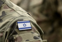 Flag of Israel on military uniform.