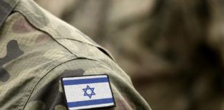 Flag of Israel on military uniform.