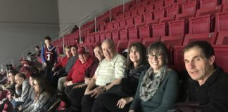 Group from Ohev Shalom in Richboro led by Jeff and Diane Pevar (far right) at Temple basketball's Jewish Heritage Night