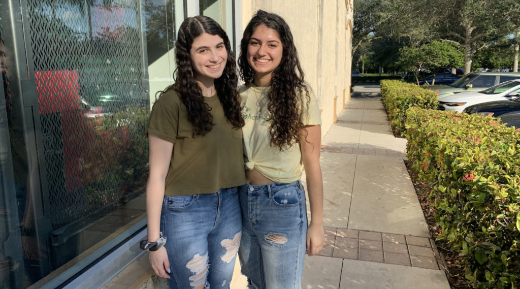 From left: Talia Rumsky and Zoey Fox-Snider say the 2018 shooting has defined their high school experience.