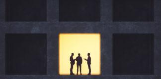 Businessmen talking in secrecy.