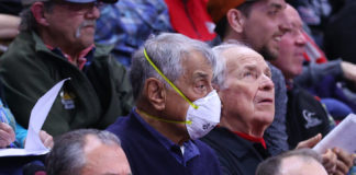 A fan wears a mask to protect against the coronavirus during the Big 10 wrestling championships at the Rutgers Athletic Center in Piscataway, N.J., March 7, 2020.