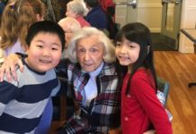Resident Betty Perlmutter with students