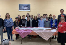 Rabbi Chaim Gelfand and Shelley Geltzer (both right), along with Alan Orefsky and Lorraine Thompson (both left), with fifth graders from PJDS.