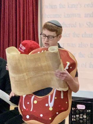 Jeremy Swartz, an eighth-grader, read two chapters of the Megillah,