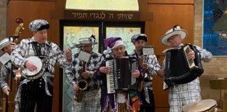 Hazzan David Tilman plays with the Mummers.