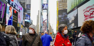 People wear face masks in Times Square in New York City, March 3, 2020, after the city confirmed cases of the rapidly spreading coronavirus.