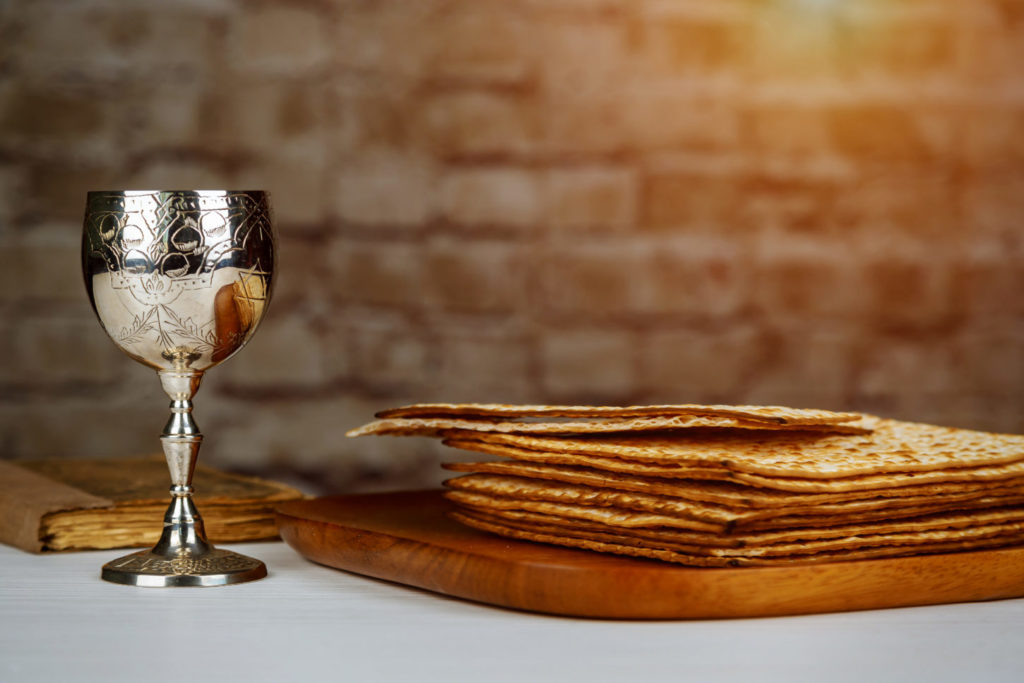 Jewish Matzah on Decorated Silver wine cup with matzah, Jewish symbols for the Passover Pesach holiday. Passover concept.
