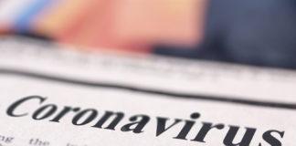 Coronavirus written newspaper close up shot to the text.