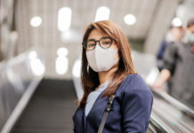 young Asian woman wearing protection mask against Novel coronavirus or Corona Virus Disease (Covid-19) at airport, is a contagious virus that causes respiratory infection.Healthcare concept