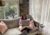 Dvora Entin sitting on a couch