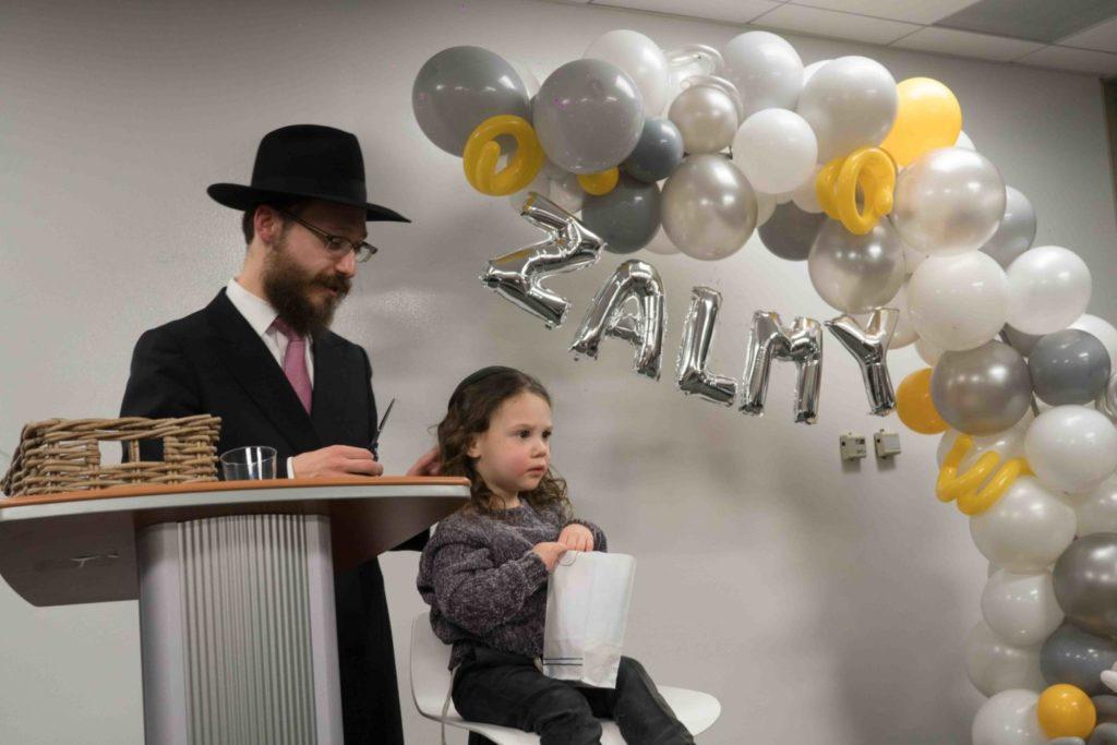 Zalmy Sputz, son of Rabbi Hirshi Sputz and Shevy Sputz, just as his upsherin begins