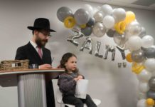 Zalmy Sputz, son of Rabbi Hirshi Sputz and Shevy Sputz, just as his upsherin begins