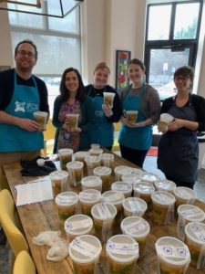 Jewish Family and Children's Service staff prepare food for clients and the Mitzvah Food Pantry with Drew Gold, kitchen manager and educator, in The Barbara and Harvey Brodsky Enrichment Center's Teaching Kitchen.