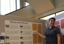 Caitlin Haskett displays her exhibit at Bryn Mawr College's Canaday Library.