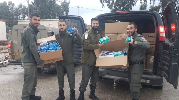 Israeli soliders with boxes