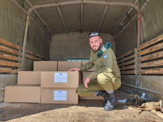 Israeli solider with boxes