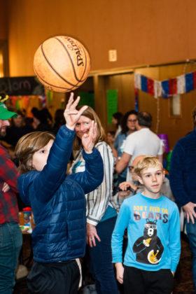 kids shooting a basketball