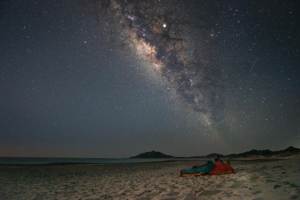 photo of the night sky on a beach