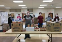 From left: Sue Aistrop, Mariya Keselman-Mekler, Andre Krug, Miranda Coyne, Andrew Maksymov, Ji-Young Ahn and Rachel Aistrop package food items.