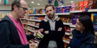Simon (Josh Howie) tries to flirt with Ruth (Rachel Gaffin) as Paul (Tim Downie) observes.