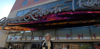 Suzanne Roberts outside the theater that bears her name
