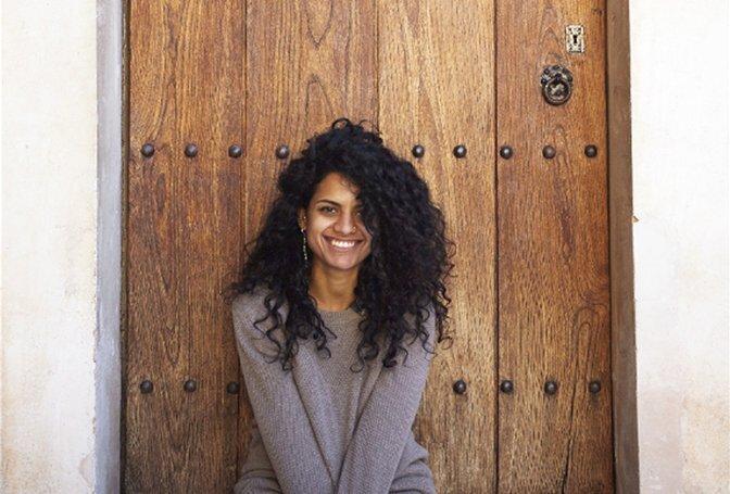 woman in front of a door