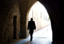 Rabbi walking through a tunnel in Jerusalem.